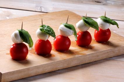 Caprese salad, typical Italian appetizer with mozzarella cheese,tomato, basil